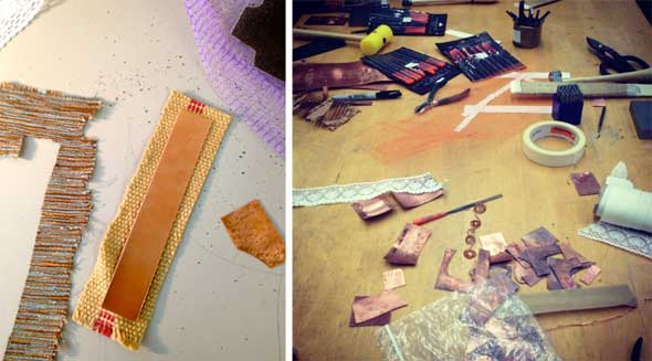 Copper and fabric scraps on the worktable; on the left, the burlap and copper strip that went through the presser